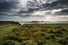 Summer landscape of Worm's Head and Rhosilli Bay in Wales Royalty Free Stock Photo
