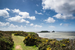 Summer landscape of Worm's Head and Rhosilli Bay in Wales Stock Photo