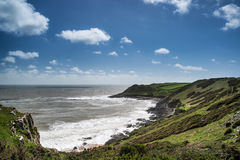 Summer landscape of Worm's Head and Rhosilli Bay in Wales Stock Photography