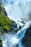 Summer Latefossen waterfall on mountain slope (Nor. Summer mountain Latefossen (or Latefoss) waterfall on slope (Odda, Norway Stock Images