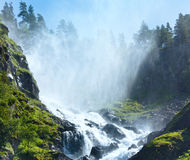 Summer Latefossen waterfall on mountain slope (Norway). Royalty Free Stock Photography