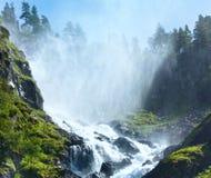 Summer Latefossen waterfall on mountain slope (Norway). Royalty Free Stock Photography