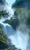 Summer Latefossen waterfall on mountain slope (Norway). Stock Photo