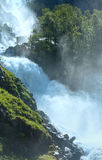 Summer Latefossen waterfall on mountain slope (Norway). Stock Photos