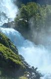Summer Latefossen waterfall on mountain slope (Norway). Stock Photos