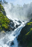 Summer Latefossen waterfall on mountain slope (Norway). Stock Images