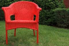 Summer Lawn Chair. Red lawn chair on a summer day Royalty Free Stock Photo