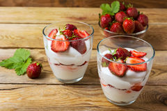 Summer layered cream cheese dessert and strawberry in glass bowl Stock Photography