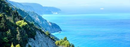 Summer Lefkada Island coast  (Greece). Summer Lefkada Island coastline  (Greece, Ionian Sea) view from up. Two shots composite picture Stock Photo