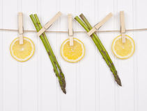 Summer Lemon Slices and Asparagus Royalty Free Stock Photography