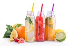 Summer lemonade bottles with lemon, strawberry and orange fruit. Royalty Free Stock Photos