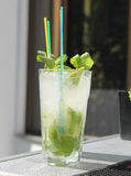 Summer lemonade mojito with lime and mint. Royalty Free Stock Photo