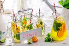 Summer lemonade with straw and fruits Royalty Free Stock Photo