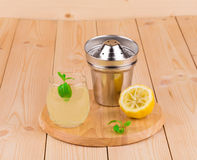 Summer lemonade on wooden background Royalty Free Stock Image