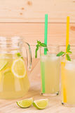 Summer lemonade on wooden background Royalty Free Stock Photo