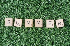 Summer letters on synthetic grass. In sunlight royalty free stock photo