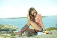 Summer life girl at seaside Stock Images