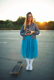 Summer lifestyle portrait of hipster girl with old camera Royalty Free Stock Photos