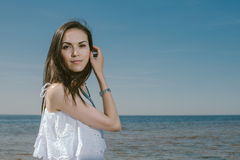 Summer Lifestyle  Portrait Woman in White Dress Smiling Near Se Stock Image