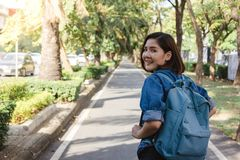 Summer lifestyle portrait of young tourist asian woman walking on the street, carry backpack. Stock Photography
