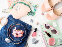 Summer lifestyle woman clothes flat lay. Summer color lifestyle woman clothes flat lay with accessories, make up and sandals stock photo
