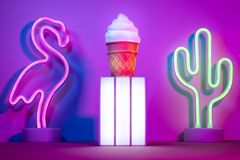 Summer with lightbox and flamingo,cactus and ice cream with neon pink and blue and green light on table with copy space.Trendy royalty free stock image