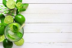 Summer limeade, top view side border on a white wood background Royalty Free Stock Photography