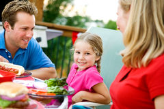 Summer: Little Girl During Family Dinner Royalty Free Stock Photography
