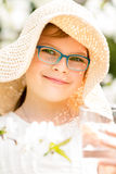 Summer little girl in straw hat drinking water outdoor portrait. Stock Photography