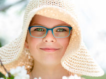 Summer little girl in straw hat outdoor portrait. Stock Image