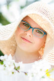Summer little girl in straw hat outdoor portrait. Royalty Free Stock Image