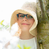 Summer little girl in straw hat outdoor portrait. Royalty Free Stock Photos