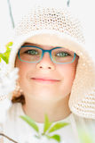 Summer little girl in straw hat outdoor portrait. Royalty Free Stock Photo