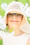 Summer little girl in straw hat outdoor portrait. Royalty Free Stock Photography