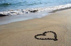 Summer love. Heart shape on the sand - irish beach Stock Photography
