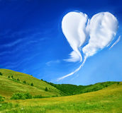 Summer love. Meadow with blue sky and heart shaped cloud Royalty Free Stock Photo
