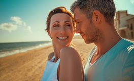 Summer love couple. Happy mid aged couple on the beach royalty free stock images