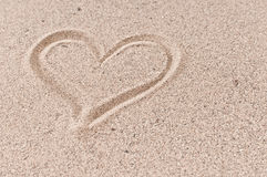 Summer love. Holiday love concept: heart in the beach sand Stock Photography