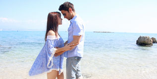 Summer love - Passionate couple next to the sea Royalty Free Stock Photo