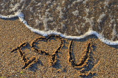Summer love by the sea shore Royalty Free Stock Photos