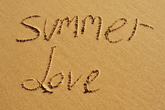 Summer love. The text summer love written in the sand of a beach Stock Images