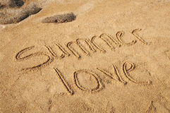 Summer Love. The words Summer Love written in the sand on the beach Stock Images