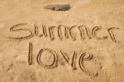 Summer Love. The words Summer Love written in the sand on the beach Royalty Free Stock Photo