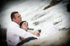 Summer lovers hugging (couple portrait). Groom holding tenderly his bride stock photo