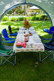 Summer lunch table under a gazebo tent Royalty Free Stock Image
