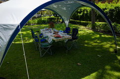 Summer lunch table under a gazebo tent Royalty Free Stock Photography