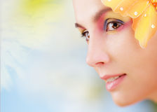 Summer make-up. Woman with colorful make-up and butterfly Stock Photography