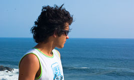 Summer Male teen. Male teen portrait with acapulco ocean view royalty free stock photos