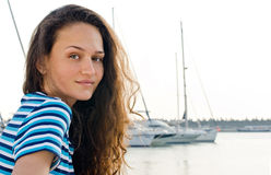Summer marine scene with a beautiful girl. Royalty Free Stock Image