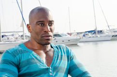 Summer marine scene with a handsome black man. Stock Image